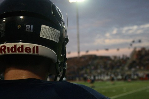 Senior Brandon Welch (21) stood on the sideline as he waited to take the field during the varsity football game on August 29.