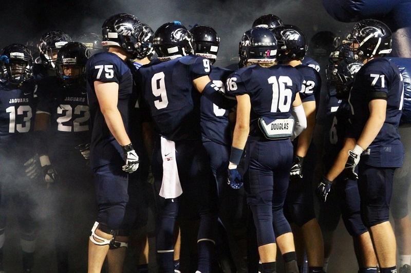 Full of anticipation for the game, varsity football got pumped up while waiting in the tunnel during last Friday's Mound Showdown.