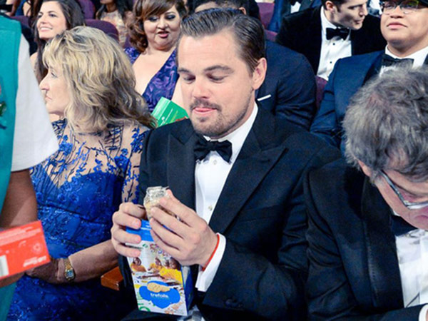 Leonardo DiCaprio admires his box of Girl Scout Cookies.