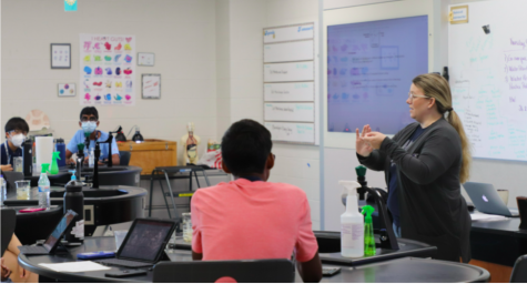 """Mrs. Smith describes an upcoming lab experiment to her first period AP Biology Class. Mrs. Smith's students remember her long after taking her class, regularly stopping by to check in. """"She's really nice and incredibly easy to talk to. She never made me feel dumb if I didn't understand something,"""" said sophomore Pranati Pradeep."""